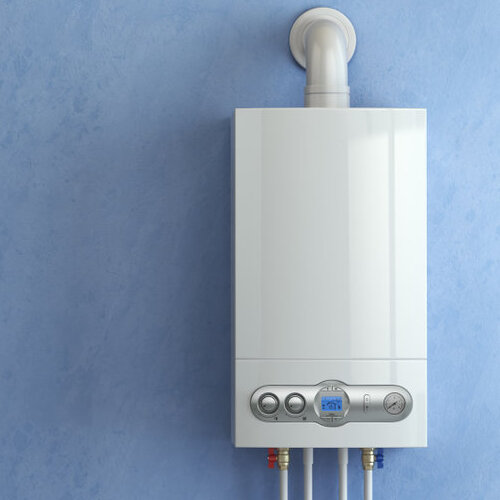 gas water heater boiler against a blue wall