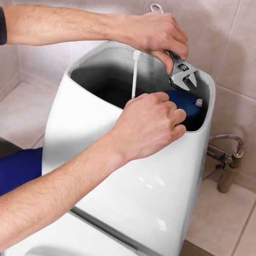 plumbing tools with toilet and plumber I background